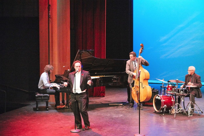 The evening's MC - Jake Broder - performing with his jazz outfit, Musical Director Corey Hirsch on piano; Kenny Elliot on percussion; Geoff Rakness on bass.